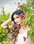 Mouni Roy Shies Away From Camera, Hides at The Back of Flowers – PICS. Mouni Roy looks beautiful in white as she shies away from the camera    Mouni...