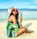 Hina Khan is still reliving her Maldavian memories    Hina Khan can be seen on the beach in a black bikini which she pairs with a green white and...