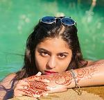 Water baby Suhana    Suhana Khan is seen posing outside the pool. She is wearing Mehendi and is giving some ****er expressions.