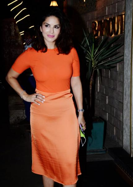 Sunny Leone wears an orange outfit for dinner date